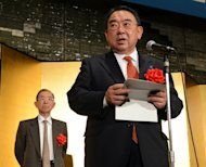New Japanese ambassador to China Masato Kitera (R) delivers a speech while former ambassador Uichiro Niwa listens during a reception in Tokyo, on December 20, 2012