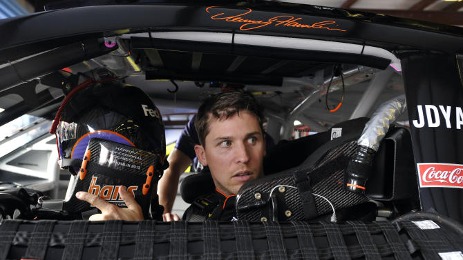NASCAR Sprint Cup series driver Denny Hamlin sits in his car as he prepares for practice at the Talladega Superspeedway in Talladega, Ala., Friday, May 3, 2013. Hamlin was back in the race car for the first time since suffering a compression fracture of a vertebra in his lower back in a last-lap crash at California on March 24.  (AP Photo/Rainier Ehrhardt)