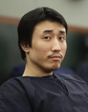 Xiao Ye Bai awaits his sentencing, Tuesday, March 5, 2013, in Las Vegas. The 26-year-old Chinese immigrant, convicted of being an enforcer for a Taiwan-based criminal gang, will spend the rest of his life in a Nevada prison for killing one person and wounding two others in a bloody knife attack in a Las Vegas karaoke bar in July 2009. (AP Photo/Julie Jacobson)
