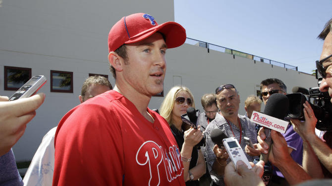 Philadelphia Phillies second baseman Chase Utley speaks to reporters during a baseball availability at Brighthouse Field in Clearwater, Fla., Sunday, March 25, 2012.  (AP Photo/Kathy Willens)