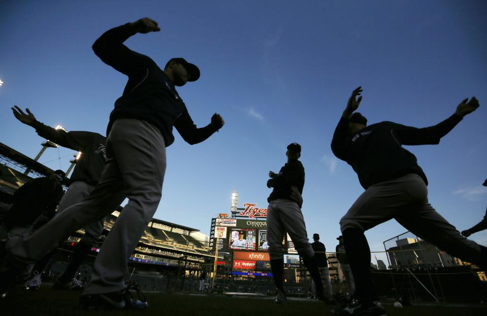 The New York Yankees stretch before the start of Game 3 of the American League championship series against the Detroit Tigers Tuesday, Oct. 16, 2012, in Detroit. (AP Photo/Matt Slocum)