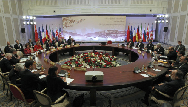 Diplomats participate in the fourth round of high-level talks with an Iranian delegation, right,  aimed at stopping the Islamic regime's nuclear program from making atomic weapons despite widespread d