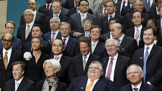 Leaders pose for a G-20 finance ministers and central bank governors group photo after their meeting at the IMF and World Bank Group Spring Meetings in Washington, Friday, April 20, 2012. Among those pictured are, first row, left to right: Mexico's finance minister Jose Antonio Meade; IMF managing director Christine Lagarde; Mexico's central bank governor Agustin Carstens; German Finance Minister Wolfgang Schaeuble. Second row, from left to right: International Monetary and Financial Committee (IMFC) chairman Tharman Shanmugaratnam; Danish economic affairs minister Margrethe Vestager; South Korean Finance Minister Bahk Jae-wan; Treasury Secretary Tim Geithner; Bank of England Governor Mervyn King; British Chancellor of the Exchequer George Osborne. Also pictured on the third row, Germany Bundesbank president Jens Weidmann, far left; Turkish Deputy Prime Minister for Economy Ali Babacan, second left; Canadian Finance Minister James Flaherty, fourth left.  (AP Photo/Charles Dharapak)