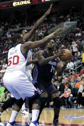 Holiday leads 76ers over Bobcats, 100-92