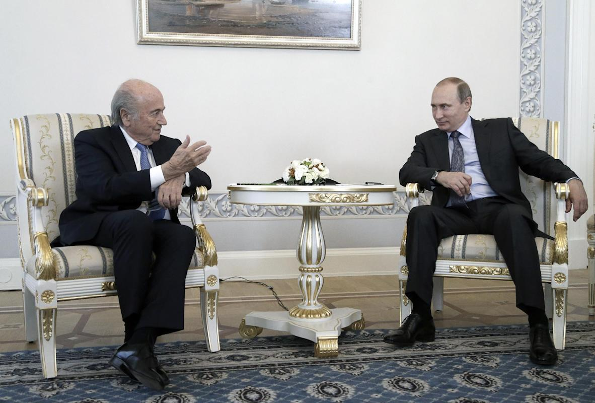 FIFA, Blatter get back to World Cup business at Putin home