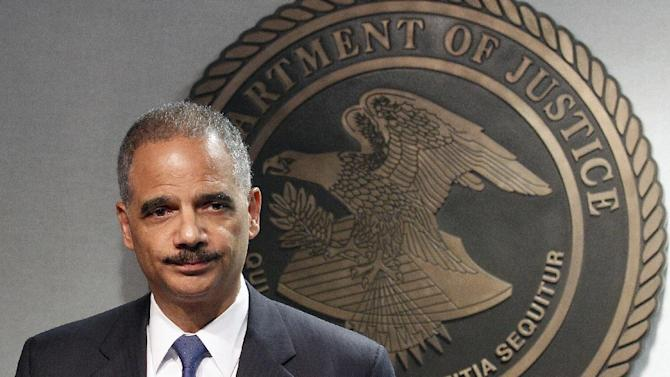 """FILE – In this June 28, 2012, file photo U.S. Attorney General Eric Holder speaks in New Orleans at a news conference called to address the bungled gun trafficking program known as Operation Fast and Furious. The Justice Department and a congressional committee now disagree on the pace of their talks to settle a lawsuit over the bungled program. In a joint filing Friday night, March 15, 2013, the House Oversight and Government Reform Committee told the judge in the case that the Justice Department's settlement offer was a """"grave disappointment,"""" adding it did not believe that Holder is serious about a settlement. (AP Photo/Bill Haber)"""
