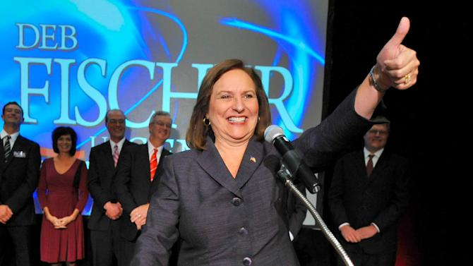 FILE - In this Nov. 6, 2012 file photo, Sen.-elect Deb Fischer, R-Neb, gestures to supporters during an election night party in Lincoln, Neb. (AP Photo/Dave Weaver, File)