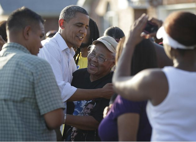 President Barack Obama greets local residents as he tours the Bridgewood neighborhood in LaPlace, La., in the Saint John the Baptist Parish for the ongoing response and recovery efforts to Hurricane I