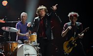 This file photo shows the Rolling Stones, Charlie Watts (L), Mick Jagger (C) and Keith Richards performing at Madison Square Garden in New York, on December 12, 2012. Influential music magazine the NME has honoured the Rolling Stones with two prizes at its annual awards show, fifty years after they first graced its pages