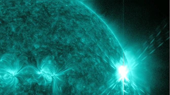 This image provided by NASA shows a solar flare early Tuesday, Aug. 9, 2011, the largest in 5 years. The image was was captured by NASA's Solar Dynamics Observatory (SDO) in extreme ultraviolet light at 131 Angstroms.  Scientists say the bursts of radiation hurled by the solar blast were not in the direction of Earth, so there'll be little impact to satellites and communication systems. (AP Photo/NASA)