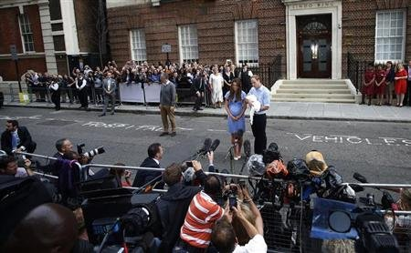 Britain's Prince William and his wife Catherine, Duchess of Cambridge appear with their baby son, outside the Lindo Wing of St Mary's Hospital, in central London July 23, 2013.