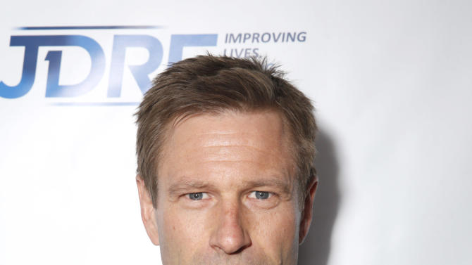 IMAGE DISTRIBUTED FOR JDRF - Aaron Eckhart attends JDRF LA's 10th Annual Finding A Cure: The Love Story Gala - Inside at the Hyatt Regency Century Plaza on Saturday, May 4, 2013 in Century City, Calif.  (Photo by Todd Williamson/Invision for JDRF/AP Images)