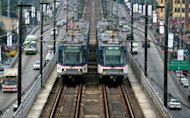Two Metro Rail Transit trains pass each other in Manila in 2010. Australia&#39;s Macquarie Group and the Asian Development Bank said Tuesday they were teaming up with other investors to open a $625 million private equity fund focused on vital infrastructure in the Philippines