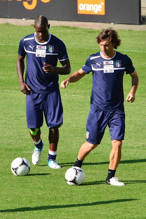Italian Midfielder Andrea Pirlo (R) And  Italian Forward Mario Balotellitake Part In A Training Session  In Krakow On AFP/Getty Images
