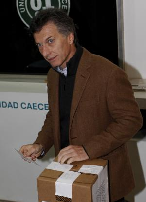 Buenos Aires Mayor Mauricio Macri casts his vote during the runoff mayoral election in Buenos Aires, Argentina, Sunday July 31, 2011. Macri, a civil engineer who jumped into politics after being president of the popular Boca Juniors football club, won the first round but failed to reach the 50 percent votes needed to win the July 10 election. The runoff pits the incumbent mayor, a conservative opponent of Argentina's President Cristina Fernandez, against her handpicked candidate, leftist Daniel Filmus.  (AP Photo/Natacha Pisarenko)