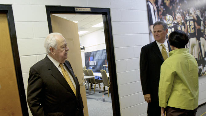 New Orleans Saints owner Tom Benson, left, his wife Gayle Benson, right, along with general manager Mickey Loomis, second from right, leave a media availability about the NFL draft at the team's training facility in Metairie, La., Thursday, April 26, 2012. (AP Photo/Matthew Hinton)