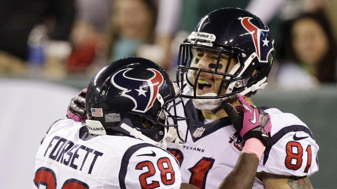 Houston Texans tight end Owen Daniels (81) celebrates a touchdown catch with running back Justin Forsett (28) during the first half of an NFL football game against the New York Jets, Monday, Oct. 8, 2012, in East Rutherford, N.J. (AP Photo/Kathy Willens)