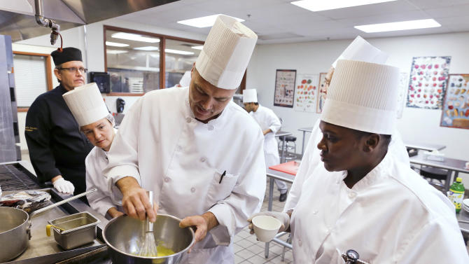Students in a professional cook class make hollandaise sauce as instructor Larry Baumann, far left, looks on at the Culinary Academy of Las Vegas, Friday, Dec. 14, 2012, in Las Vegas. The academy is funded through a trust created by the culinary and bartenders unions as well as management from 26 properties on the Las Vegas Strip. Nevada has become an increasingly Democratic state. And the Culinary Union's track record gives a dispirited labor movement some hope even as it continues to hemorrhage workers and reels from the signature of a right-to-work law in Michigan this week. (AP Photo/Julie Jacobson)