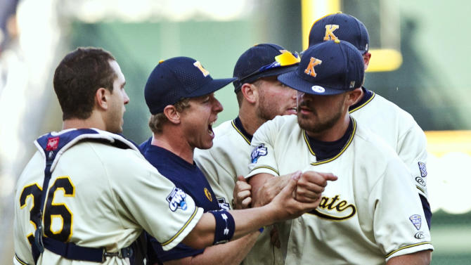 Kent State catcher David Lyon (36) and teammates mob closing pitcher Josh Pierce, right, after the last out against Florida in an NCAA College World Series elimination baseball game in Omaha, Neb., Monday, June 18, 2012. Kent State won 5-4. (AP Photo/Nati Harnik)