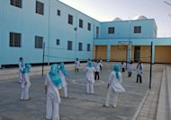 "File photo of female Afghan prisoners playing volleyball at a prison in the eastern Afghan city of Herat. Hundreds of Afghan women are languishing in prison having been accused or convicted of so-called ""moral crimes"", including ""running away"" and having sex outside marriage, campaign group Human Rights Watch said March 27, 2012"