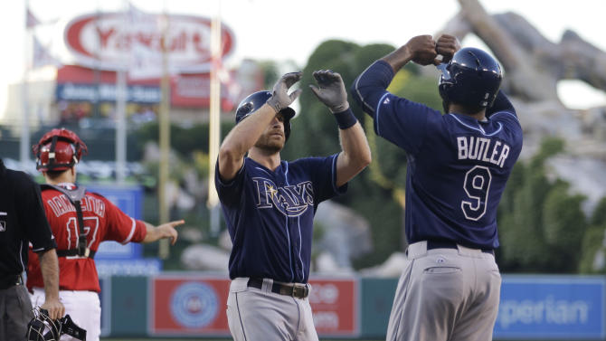 Tampa Bay Rays' Logan Forsythe, center, celebrates his two-run home run with Joey Butler during the first inning of a baseball game against the Los Angeles Angels, Tuesday, June 2, 2015, in Anaheim, Calif. (AP Photo/Jae C. Hong)