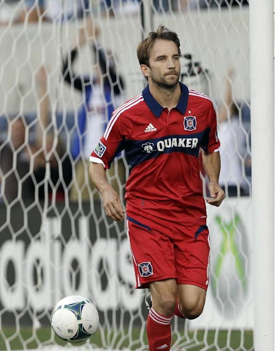In this June 19, 2013, file photo, Chicago Fire midfielder Mike Magee celebrates after scoring from a penalty kick during an MLS soccer game against the Colorado Rapids in Bridgeview, Ill. Magee was s
