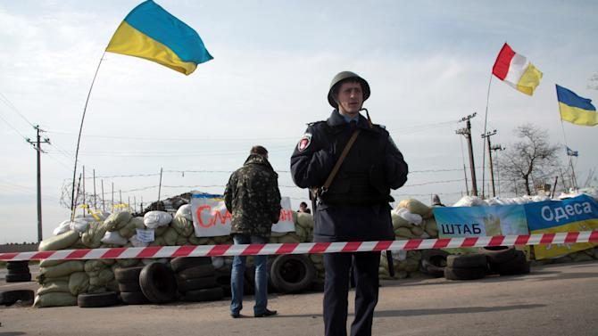 Ukraine tensions roil markets, Amazon disappoints