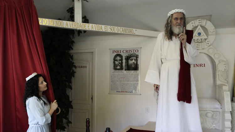 Cristo, religious leader who claims to be Jesus Christ reincarnated, gestures on stage in Brasilia