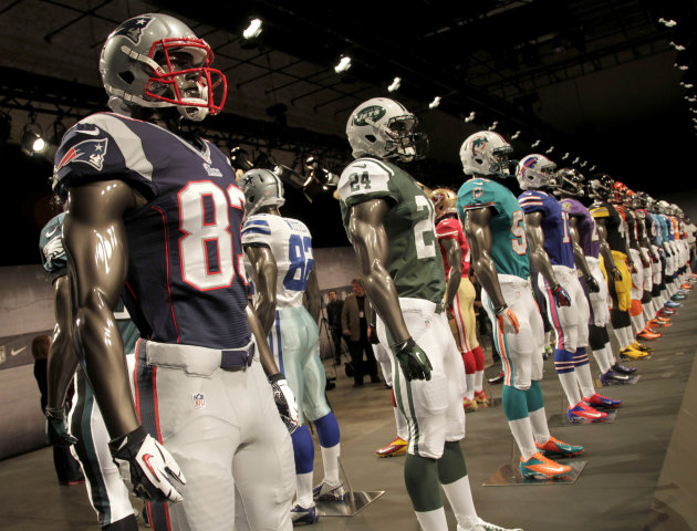 New NFL uniforms are displayed on mannequins during a presentation in New York, Tuesday, April 3, 2012.  The NFL and Nike showed off the new look in grand style with a gridiron-styled fashion show at