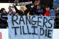 Rangers' fans show their support for the club during a Scottish Premier League football match in Glasgow, in February 2012. A consortium led by former Rangers director Paul Murray lodged a formal bid for the stricken Glasgow giants on Friday, subject to approval from creditors