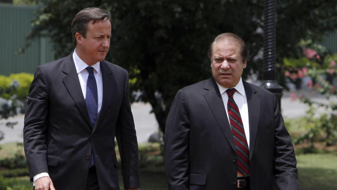 British Prime Minister David Cameron, left, with his Pakistani counterpart Nawaz Sharif arrive for joint press conference in Islamabad, Pakistan, Sunday, June 30, 2013. Cameron is in Islamabad on a tow-day visit to hold talks with Pakistani top leaders on bilateral interest, regional and international importance including the peace process in Afghanistan. (AP Photo/Anjum Naveed)