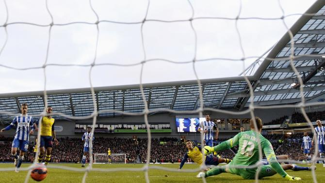Arsenal's Ozil scores a goal against Brighton and Hove Albion during their FA Cup fourth round soccer match at the Amex stadium in Brighton
