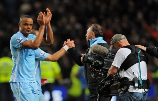 Manchester City's Vincent Kompany applauds the crowd