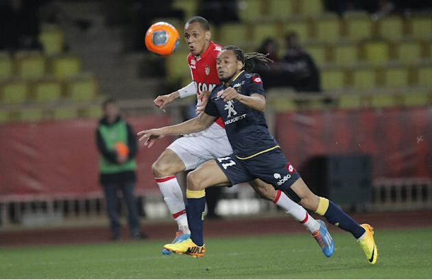Monaco's Fabinho of Brazil, left, challenges Sochaux player Roy Contout of France for the ball during their French League One soccer match, in Monaco stadium, Saturday March 8, 2014