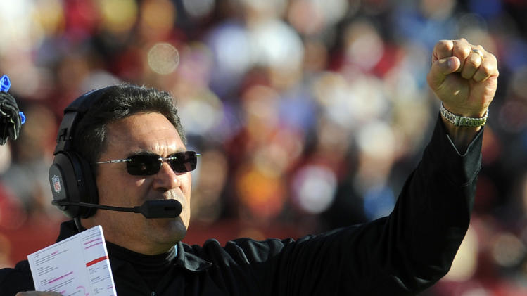 Carolina Panthers head coach Ron Rivera reacts after a score during the first half of an NFL football game against the Washington Redskins, Sunday, Nov. 4, 2012, in Landover, Md. (AP Photo/Richard Lipski)