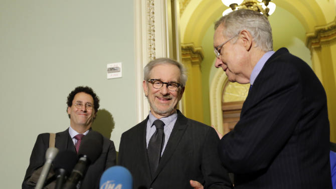 """Writer Tony Kushner, left, director Steven Spielberg, and Senate Majority Leader Harry Reid of Nevada, pause during a media availability before a screening of the movie """"Lincoln,"""" for members of Congress, on Capitol Hill, Wednesday, Dec. 19, 2012 in Washington. (AP Photo/Alex Brandon)"""