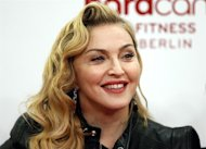 "In this Oct. 17, 2013 photo, U.S. pop star Madonna smiles during her visit at the ""Hard Candy Fitness"" center in Berlin. THE CANADIAN PRESS/AP, Michael Sohn"