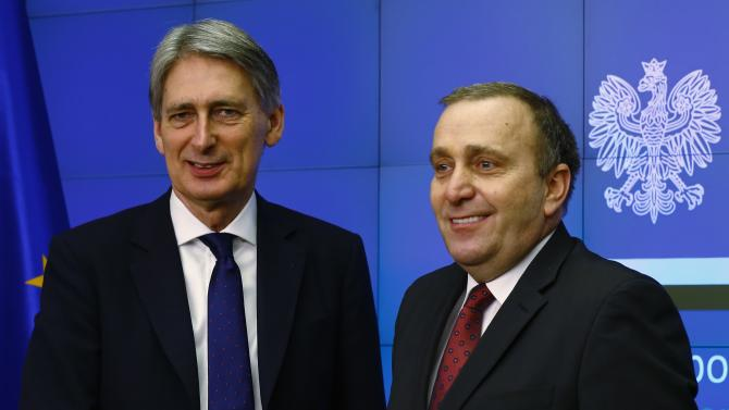 Poland's Foreign Minister Schetyna and Britain's Foreign Secretary Hammond smile during news conference at the Foreign Ministry in Warsaw