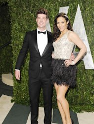 FILE - In this Sunday, Feb. 26, 2012 file photo, singer Robin Thicke and wife actress Paula Patton arrive at the Vanity Fair Oscar party in West Hollywood, Calif. Robin Thicke wrote and produced the 2004 Usher song Can U Handle It, which features vocals from his wife, actress Paula Patton. He says though she can sing, Patton doesnt have plans to release her own music. (AP Photo/Evan Agostini, File)