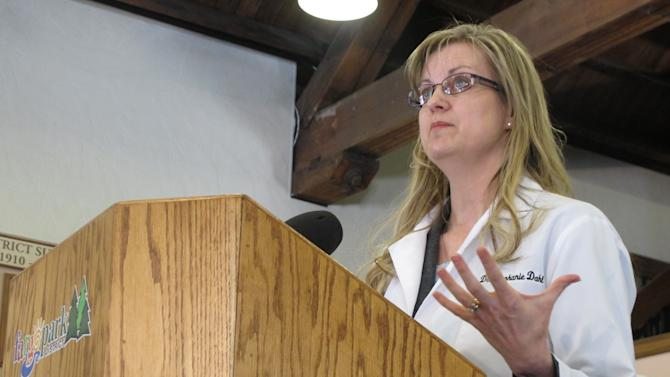Dr. Stephanie Dahl, a Fargo infertility specialist, speaks out against two anti-abortion bills in the North Dakota Legislature during a news conference Monday, March 18, 2013, in Fargo, N.D. Dahl says the bills could restrict or ban in vitro fertilization. (AP Photo/Dave Kolpack)