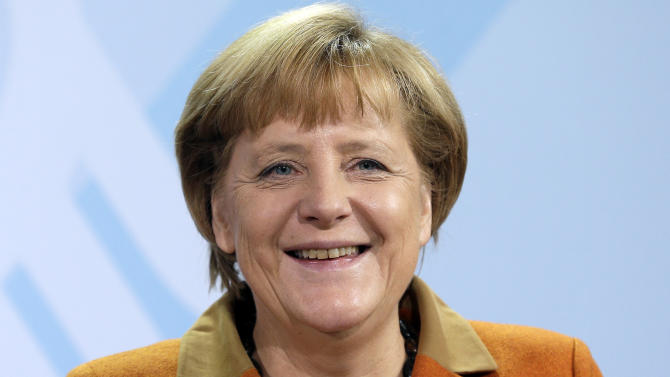 German Chancellor Angela Merkel smiles during a presentation by the German government's independent panel of economic advisers of the prognosis for Germany's economy in the upcoming year at the chancellery in Berlin, Germany, Wednesday, Nov. 7, 2012. (AP Photo/Michael Sohn)