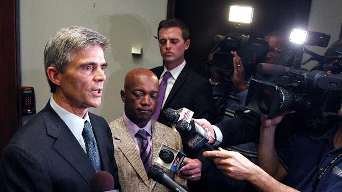 Superdome manager Doug Thornton, left, and Charles Rice, president and CEO of Entergy New Orleans, talk about the power outage during the Super Bowl, at a news conference at City Hall in New Orleans, Tuesday, Feb. 5, 2013. (AP Photo/Jonathan Bachman)