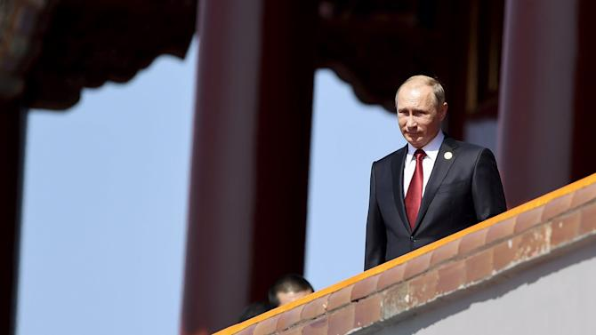 Russia's President Putin is seen on the Tiananmen Gate, at the beginning of the military parade marking the 70th anniversary of the end of World War Two, in Beijing