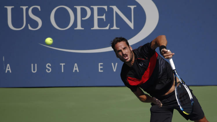 Feliciano Lopez, of Spain, serves against Ivan Dodig, of Croatia, during the second round of the 2014 U.S. Open tennis tournament, Wednesday, Aug. 27, 2014, in New York. (AP Photo/Kathy Willens)