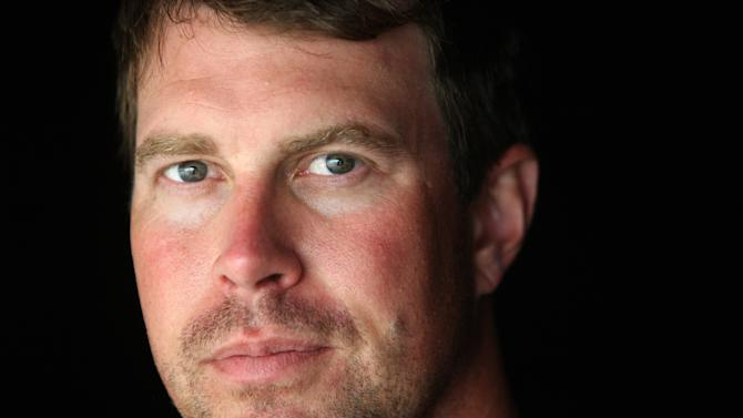 FILE - In this July 27, 2010, file photo, former NFL quarterback Ryan Leaf is shown in Holter Lake, Mont. Authorities say Leaf was arrested in his Montana hometown on burglary and drug possession charges on Friday, March 30, 2012. (AP Photo/Mike Albans, File)
