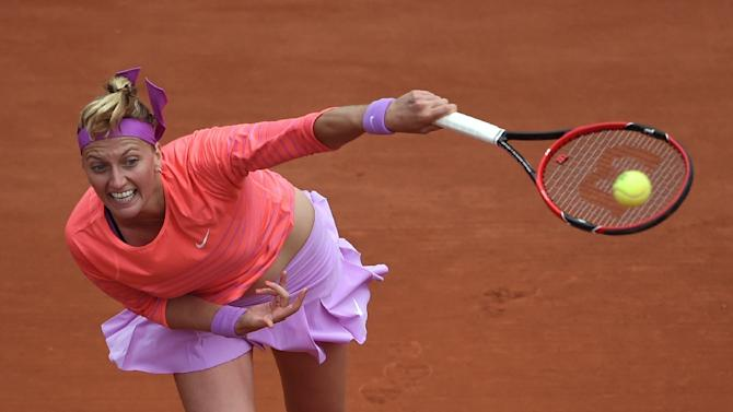 Petra Kvitova of the Czech Republic serves to New Zealand's Marina Erakovic in the first round of the French Open on May 26, 2015