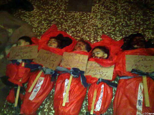 This citizen journalism image provided by the Local  Coordination Committees in Syria and released on Friday Jan. 27, 2012, purports to show the bodies of five Syrian children wrapped in plastic bags, with signs in Arabic identifying them by name. Activists say the children were killed in a shelling attack by Syrian forces, in the Karm el-Zaytoun neighborhood of Homs, Syria, on Thursday Jan. 26, 2012 A