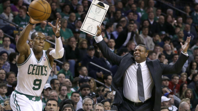 Boston Celtics head coach Doc Rivers, right, gestures for a time out as Boston Celtics point guard Rajon Rondo (9) handles the ball with under a minute left in the second quarter of an NBA basketball game against the New Orleans Hornets in Boston, Wednesday, Jan. 16, 2013. (AP Photo/Elise Amendola)
