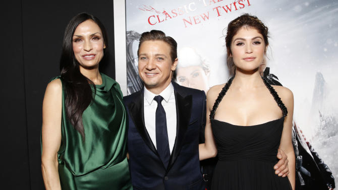 "Famke Janssen, Jeremy Renner and Gemma Arterton arrive at the premiere of ""Hansel & Gretel Witch Hunters"" on Thursday Jan. 24, 2013, in Los Angeles.  (Photo by Todd Williamson/Invision/AP)"