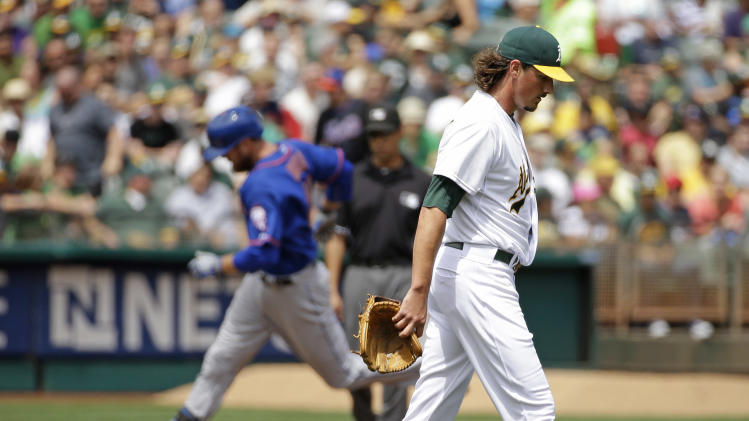 Oakland Athletics starting pitcher Jeff Samardzija, right, walks back to the mound after giving up a three run homer to the New York Mets' Lucas Duda, left, during the third inning of their interleague baseball game Wednesday, Aug. 20, 2014, in Oakland, Calif. (AP Photo/Eric Risberg)